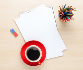 Office desk table with supplies and coffee cup