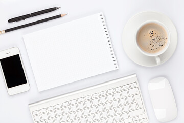 Office desk table with computer, supplies and coffee cup