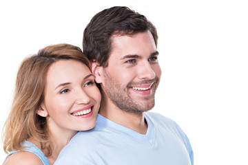Portrait of smiling embracing couple.