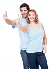 Portrait of happy couple with thumbs up.