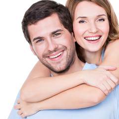 Closeup portrait of beautiful happy couple.