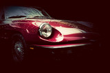 Retro classic car on dark background. Vintage, elegant poster