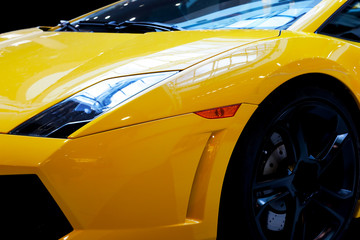 Modern fast car close-up background. Luxury, expensive