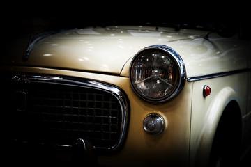 Retro classic car on black background. Vintage, elegant