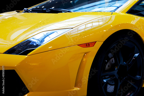Billede Modern fast car close-up background. Luxury, expensive