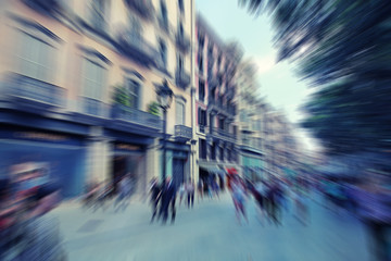 Abstract background. Pedestrians walking in Barcelona, Spain.