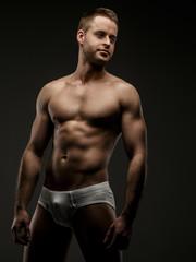 Man in white panties posing in studio