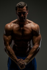 Awesome muscular guy posing in studio