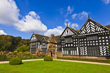 Timber framed medieval mansion house and gardens.