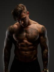Muscular guy looking down
