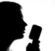 Silhouette of a man with microphone.