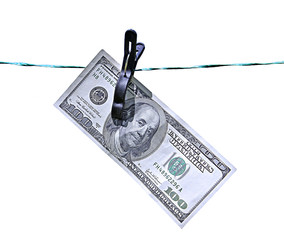 The banknote one hundred dollars on the clothesline isolated