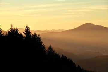 sunset over misty mountains