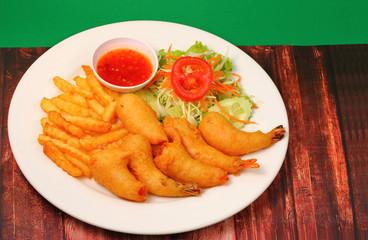 prawns in crispy batter and salad