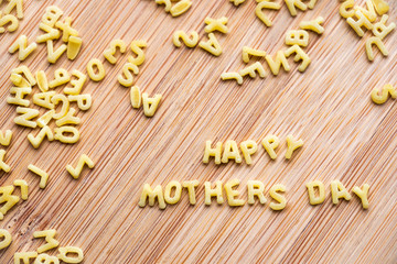 Alphabet pasta forming the text Happy Mothers Day