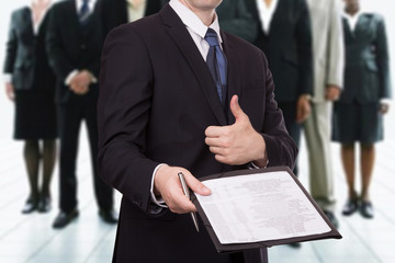 Businessman giving a contract to you