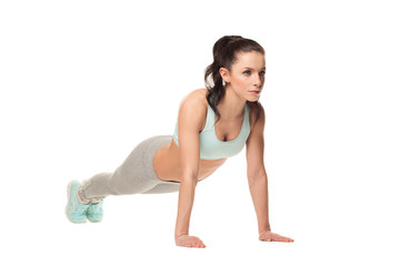athletic woman doing push-ups . Fitness model