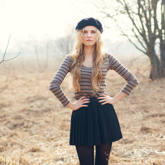 beautiful girl in a beret in spring park