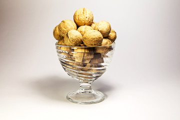 solid walnuts in a glass bowl
