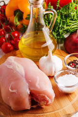 Raw chicken breasts on a cutting board