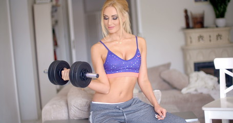 Fit young woman working out at home