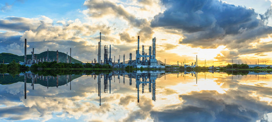 Refinery with the morning sunrise and cloud with reflection