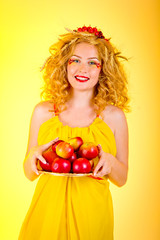 Beautiful girl dressed yellow with apples