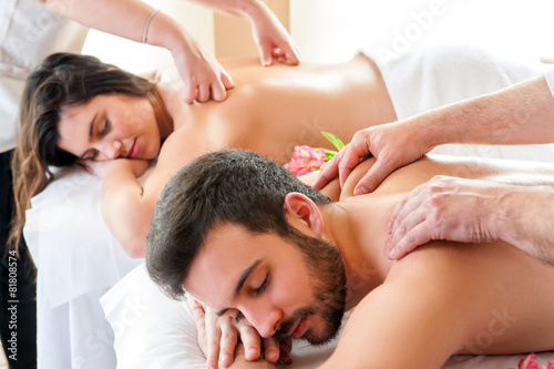 Couple having relaxing body massage in spa. - 81808574
