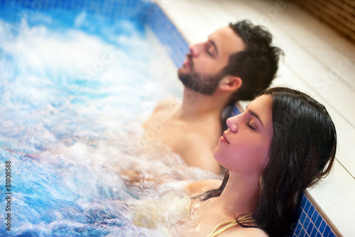 Leinwandbild Motiv Couple relaxing in spa jacuzzi.