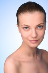 Headshot of young woman with pure skin