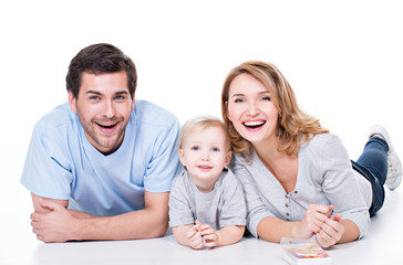 Smiling young family with little child.