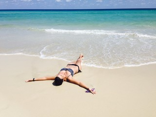 Girl lying on caribbean beach