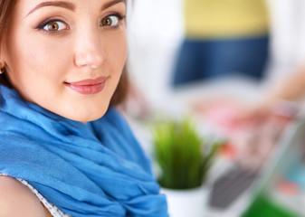 Portrait of attractive female  designer in office