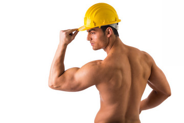 Muscular young construction worker shirtless  seen from back