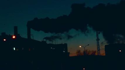 Smokestack in factory wat night