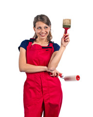 woman in red overalls with painting tools