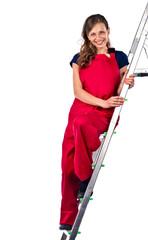 young woman in a red jumpsuit on  ladder