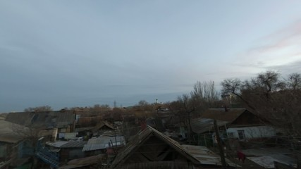 Rural scene timelapse. Sunset clouds over slum houses