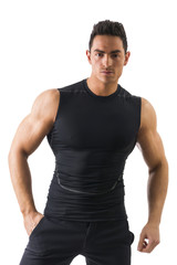 Handsome athletic young man in black t-shirt isolated