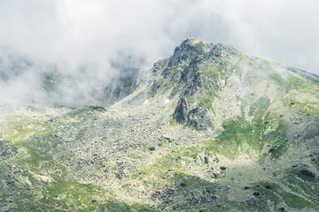 Rocky mountain peak covered in fog