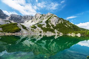Rocky Mountain Peak by turquoise blue lake