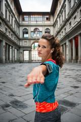 Fitness woman workout near uffizi gallery in florence, italy