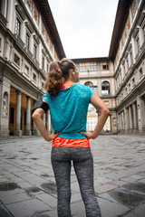 Fitness woman standing in front of uffizi gallery in florence