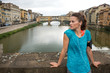 Fitness woman standing in front of ponte vecchio in florence