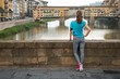 Fitness woman looking on ponte vecchio in florence, italy