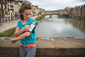 Fitness woman jogging near uffizi gallery in florence, italy