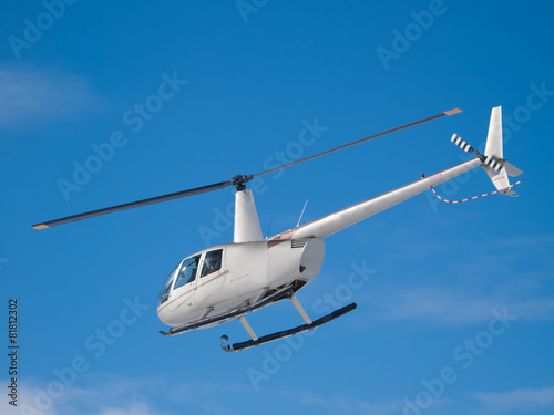 Helicopter flying in the blue sky - 81812302