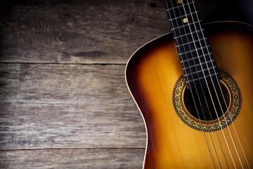 Guitar against a rustic wood