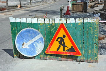 Sign and fence on road construction work