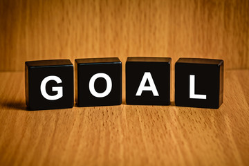 business goal word on black block